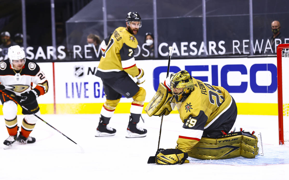 Golden Knights goaltender Marc-Andre Fleury (29) stops the puck during the third period of an N ...