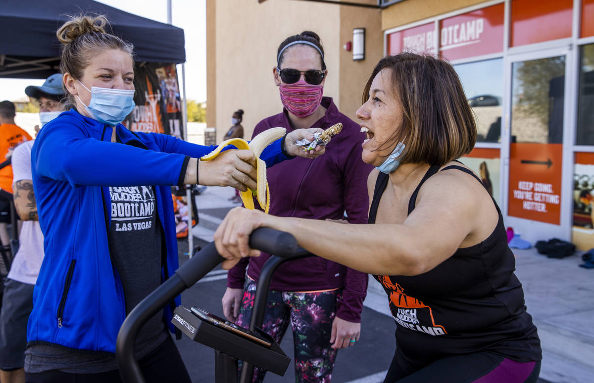 Yanet Martinez, right, is offered a choice of granola bar or banana while pedaling from Sandy R ...