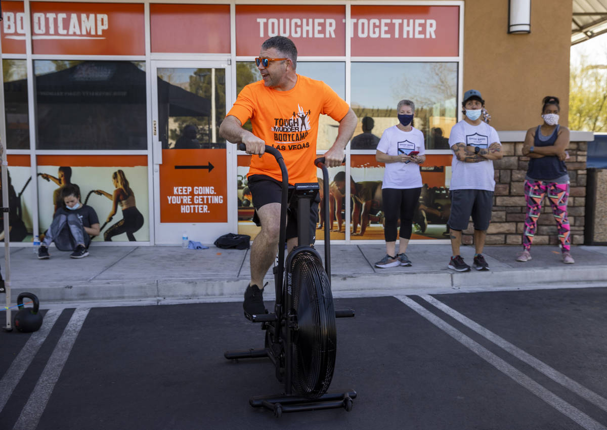 Co-owner Cory Drumright pedals some miles as Tough Mudder Bootcamp Las Vegas members pedal 96 m ...