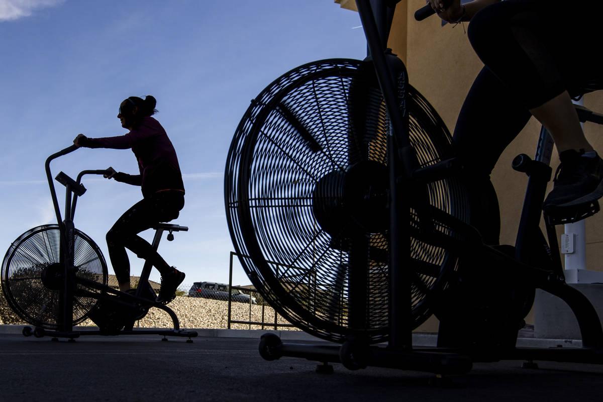 Megan Kock pedals as Tough Mudder Bootcamp Las Vegas members pedal 96 miles on stationary bikes ...