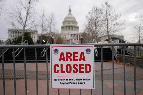 FILE - In this Monday, Jan. 11, 2021, file photo, signs are posted to close the area around the ...
