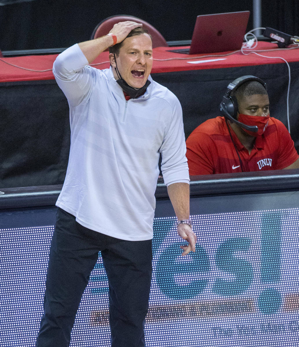 UNLV Rebels head coach T. J. Otzelberger yells a play into his players versus the New Mexico Lo ...