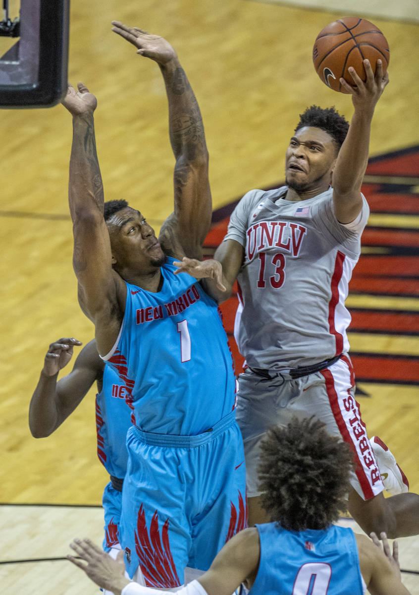 UNLV Rebels guard Bryce Hamilton (13) goes up to the net strong versus New Mexico Lobos forward ...