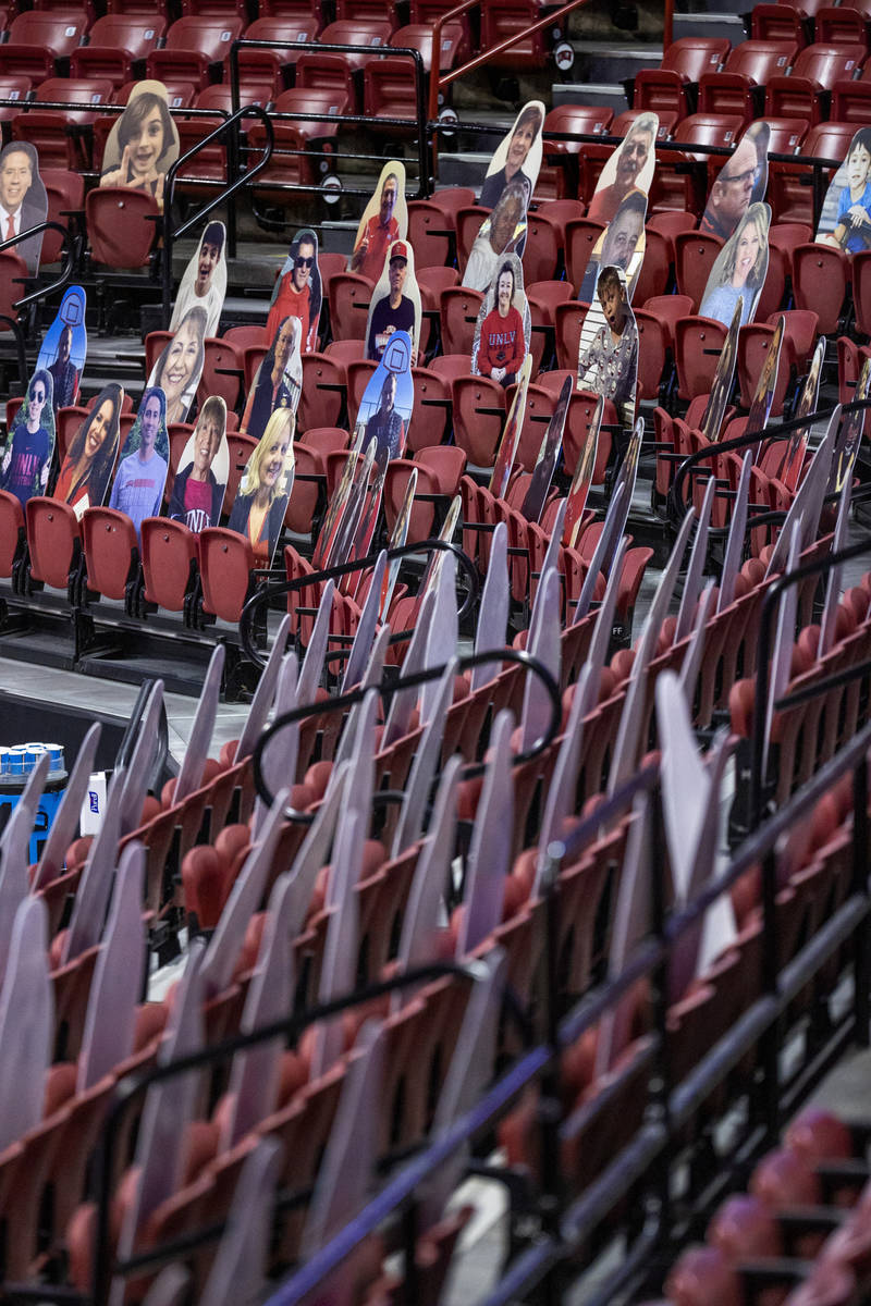 Cardboard cutouts of fans line the lower part of the arena as the UNLV Rebels battle the New Me ...