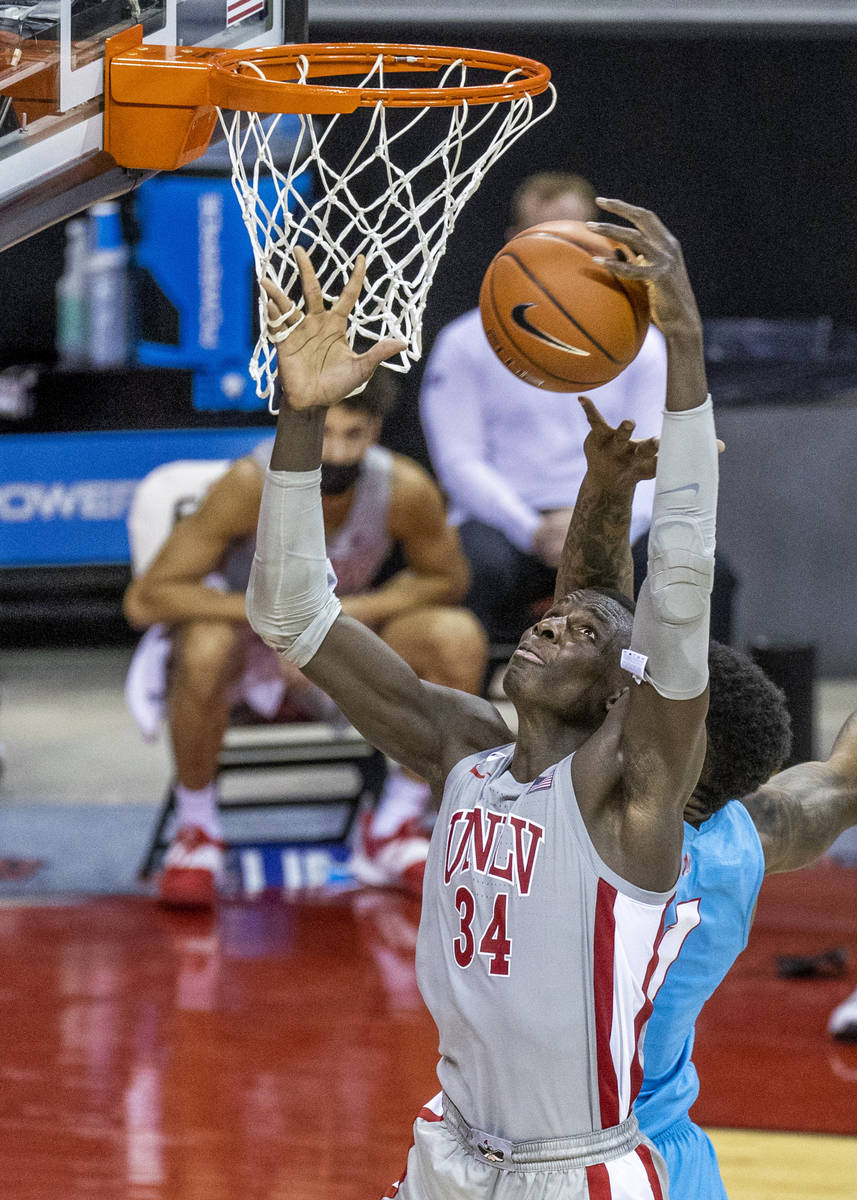 UNLV Rebels forward Cheikh Mbacke Diong (34) gets a hand in the net while securing a rebound ov ...