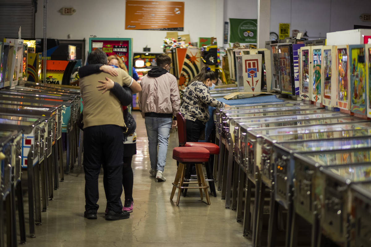 Individuals are seen in the Pinball Hall of Fame during the launch of a weekly food truck gath ...