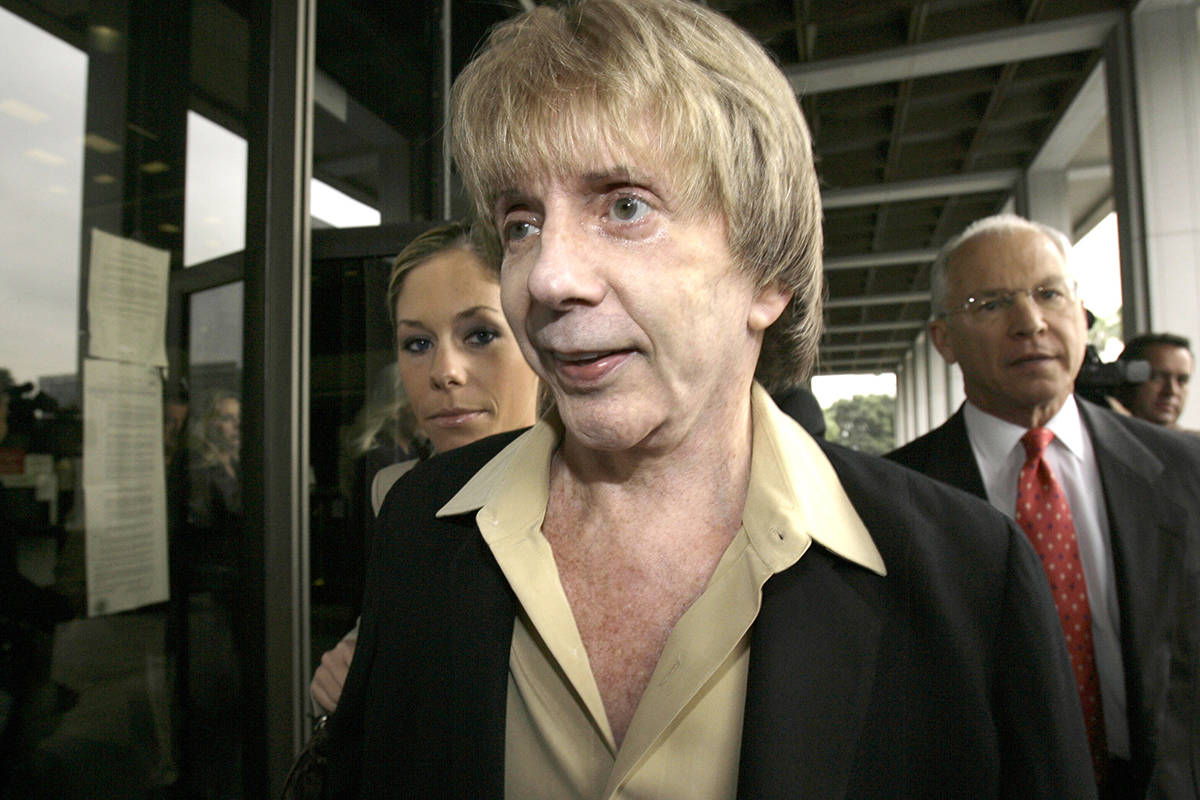 FILE - In this March 19, 2007 file photo, music producer Phil Spector and his attorney, Roger R ...