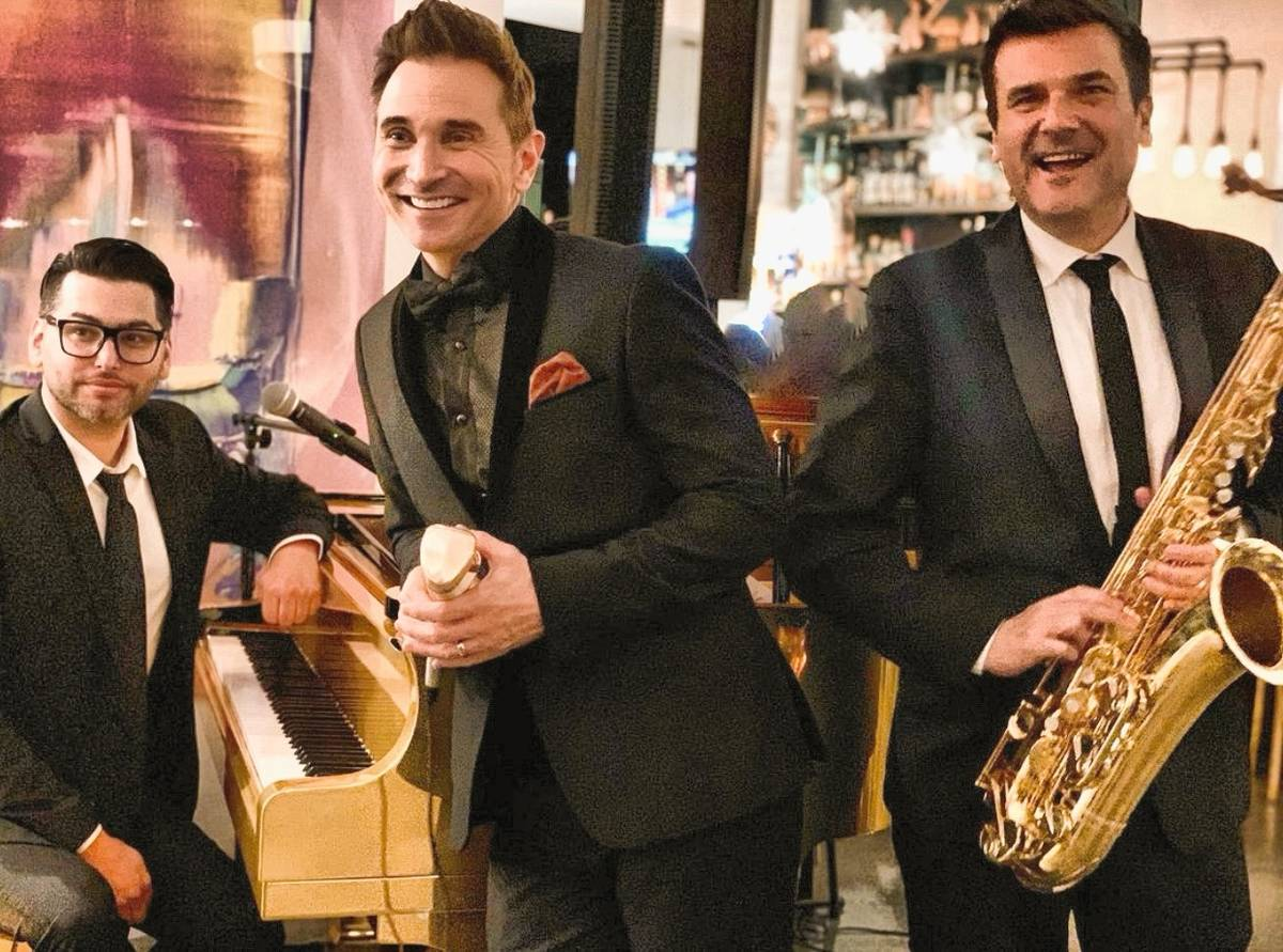 Chris Lash, Travis Cloer and Eric Tewalt are shown at DW Bistro at the Gramercy on Dec. 31, 202 ...