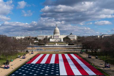 A large American Flag is are placed on the National Mall, with the U.S. Capitol behind, ahead o ...