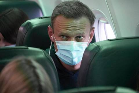 Alexei Navalny sits on the plane prior to a flight to Moscow, at the Airport Berlin Brandenburg ...