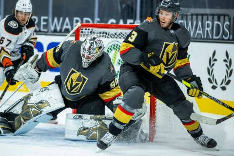 Golden Knights goaltender Robin Lehner (90) looks to block a shot with teammate defenseman Bray ...