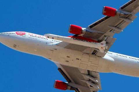 Virgin Orbit Boeing 747-400 rocket launch platform, named Cosmic Girl, takes off from Mojave Ai ...