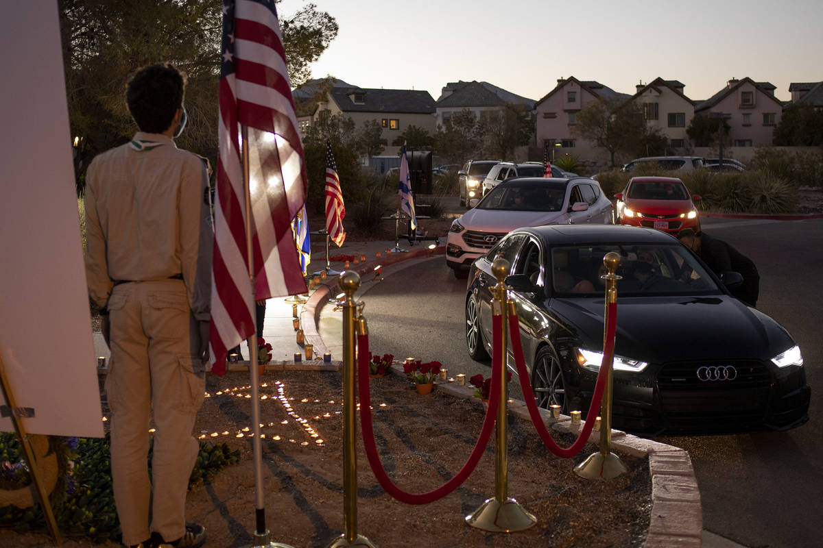 Members of the Jewish community drive through to pay their respects to Sheldon Adelson by light ...