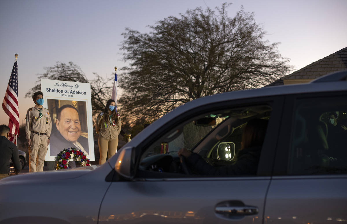 Members of the Jewish community pay their respects to Sheldon Adelson by participating in a dri ...
