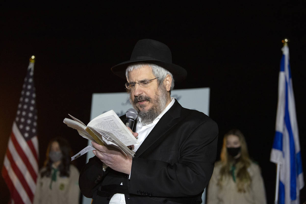 Rabbi Shea Harlig of Chabad of Southern Nevada reads Psalms during a tribute to the late Sheldo ...
