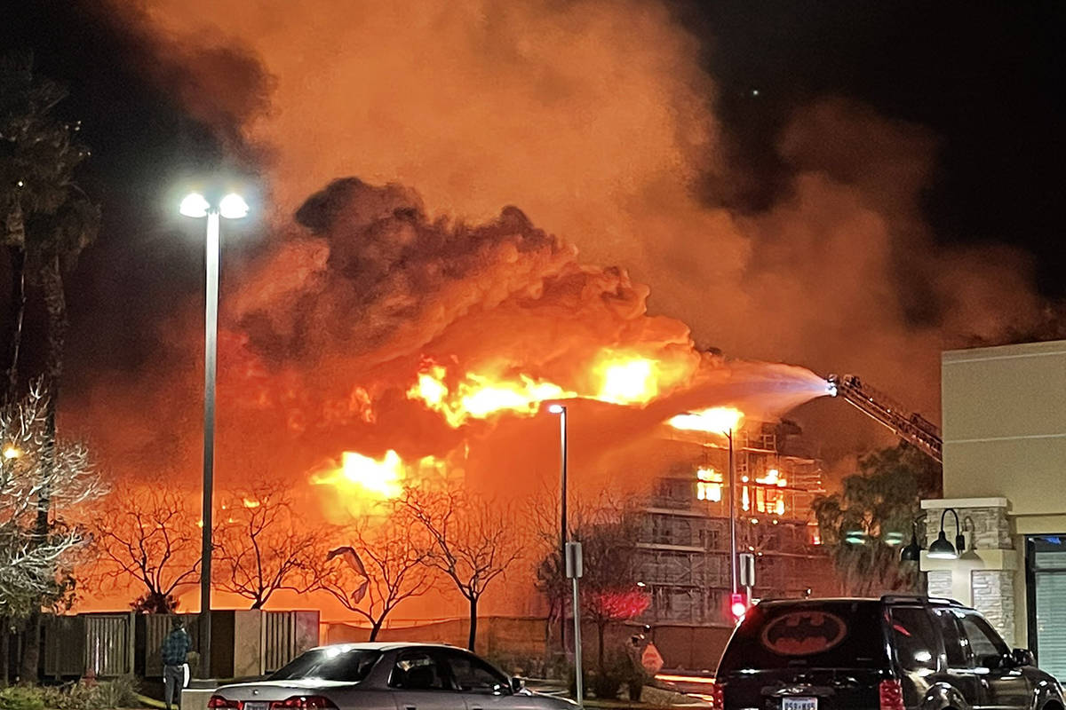 Fire crews battle a large fire in southwest Las Vegas early Tuesday, Jan. 19, 2021. (Dominic Gi ...