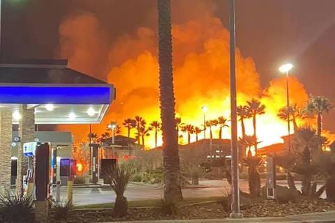 Fire crews battle a large fire in southwest Las Vegas early Tuesday, Jan. 19, 2021. (Joshua Taylor)