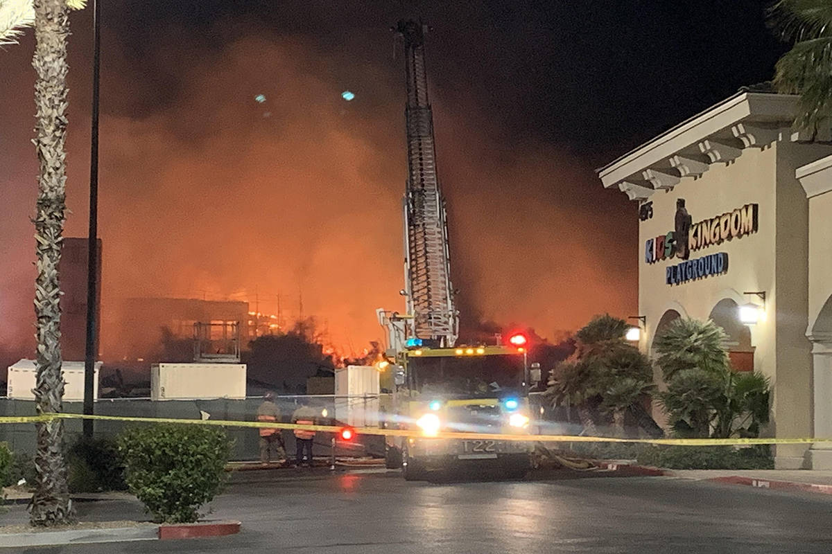 Fire crews battle a large fire in southwest Las Vegas early Tuesday, Jan. 19, 2021. (Alexis For ...
