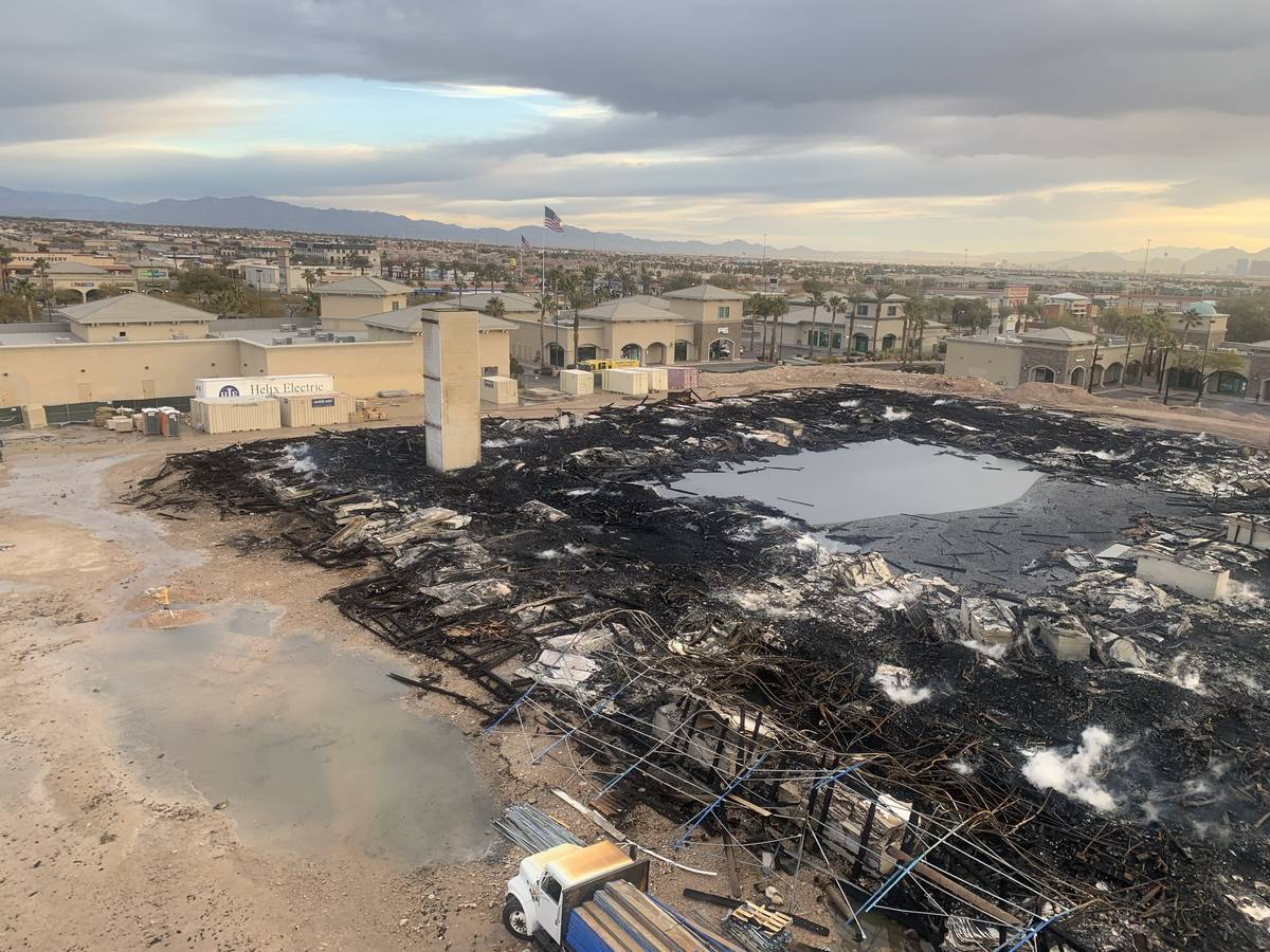 The aftermath of an overnight fire at an under-construction apartment complex in southwest Las ...