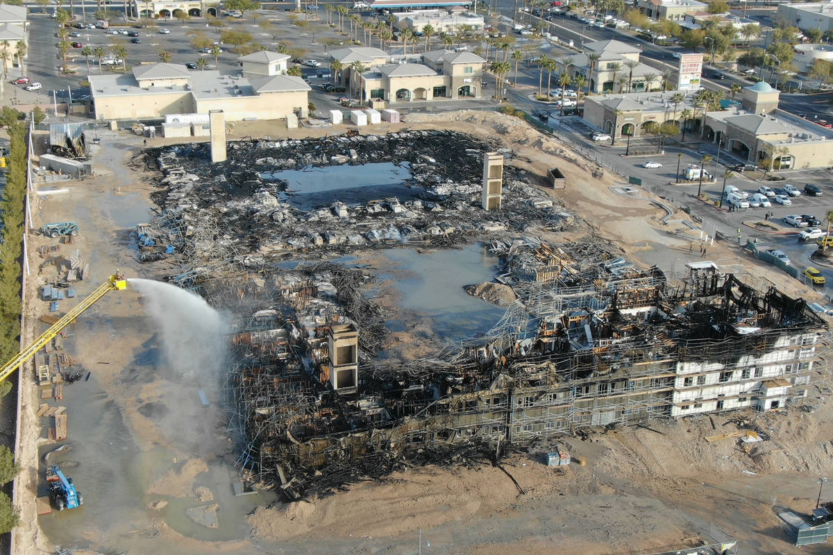 An aerial view of the damage after an overnight fire at an under-construction apartment complex ...