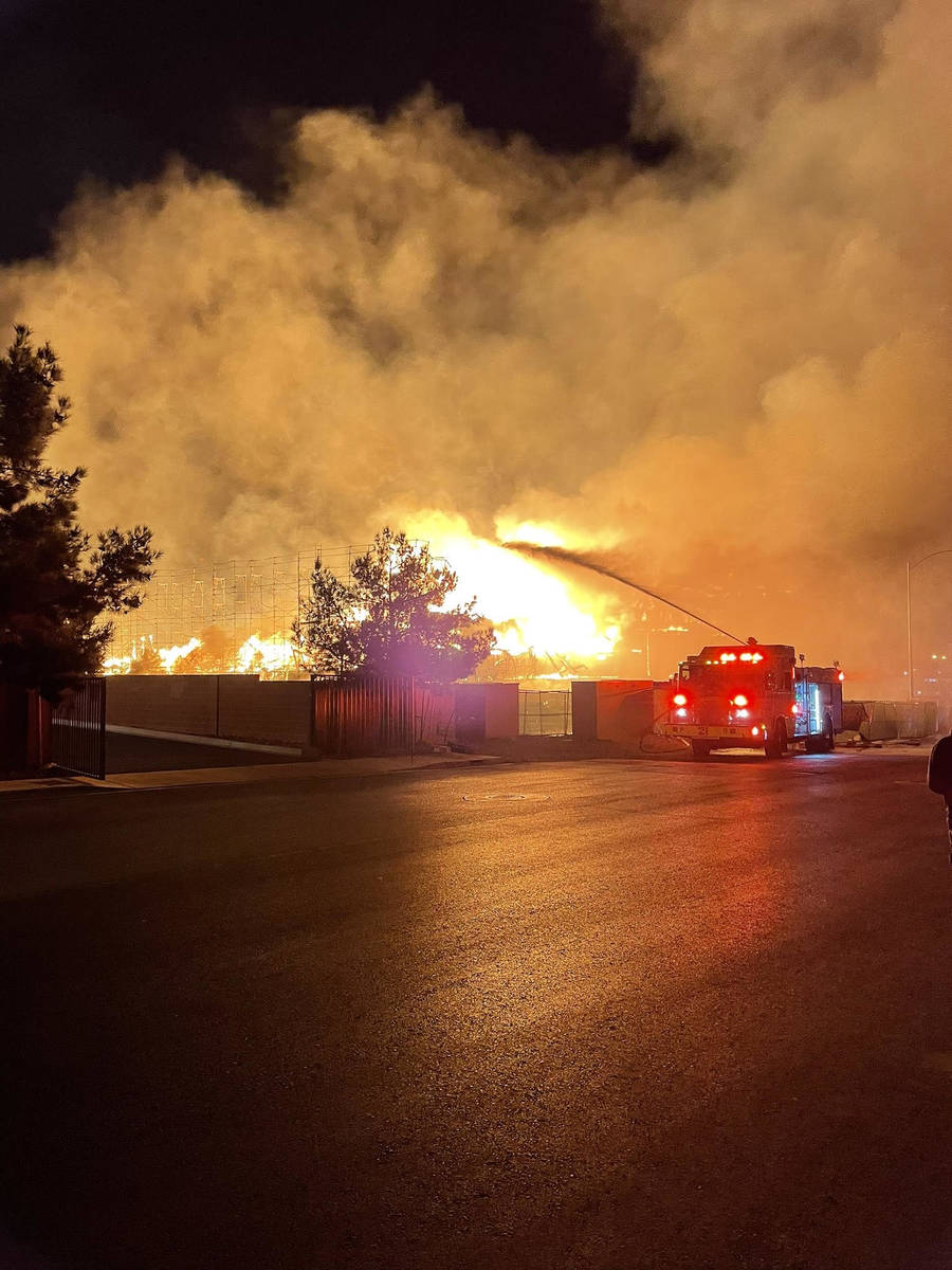 Fire crews battle a large fire in southwest Las Vegas early Tuesday, Jan. 19, 2021. (Dillon Nie ...