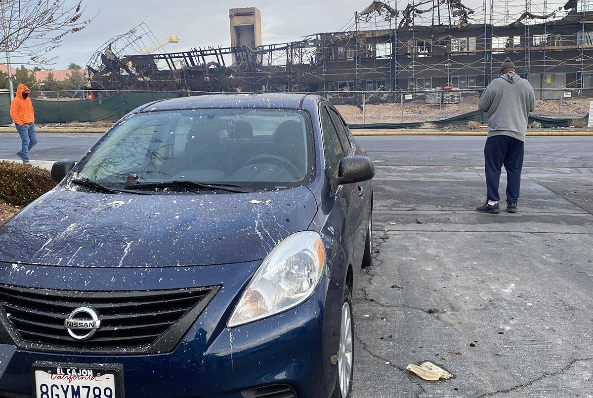 Debris from covers a car near the southwest Las Vegas scene of a Monday, Jan. 18, 2021, fire at ...