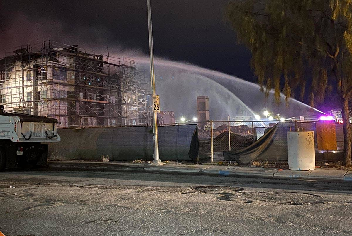 Clark County firefighters work to extinguish a hot spot early Tuesday, Jan. 19, 2021. The crew ...