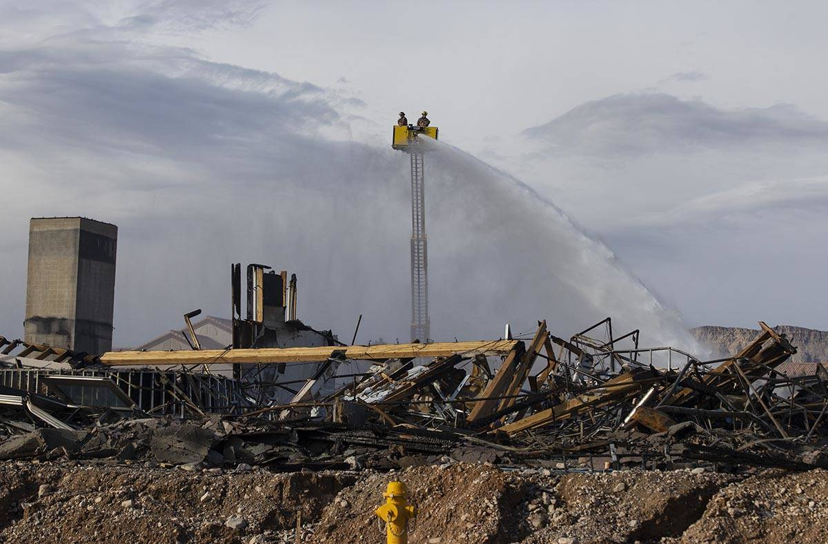 Clark County firefighters spray water at an under-construction Ely at Fort Apache apartment com ...