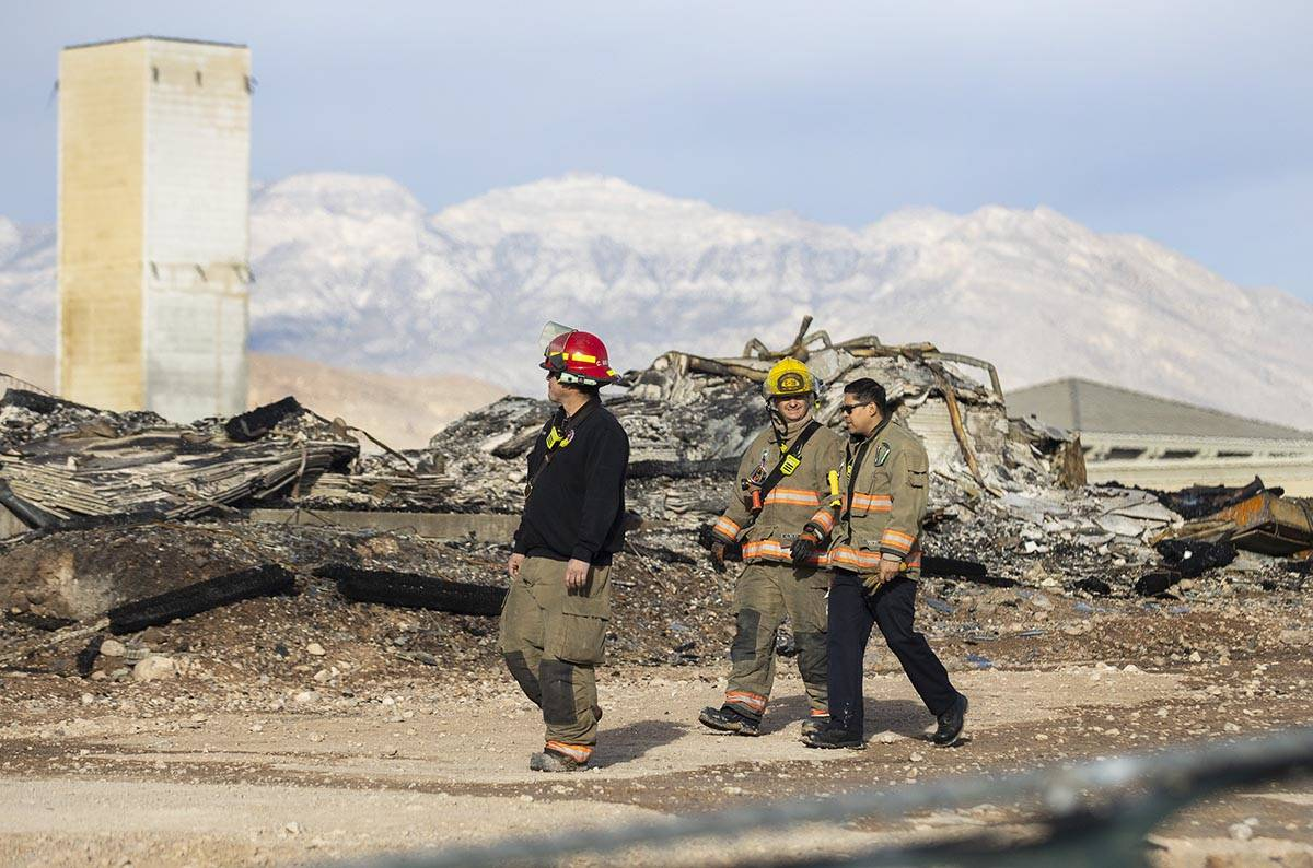 Clark County firefighters survey the damage done by fire to an under-construction Ely at Fort A ...