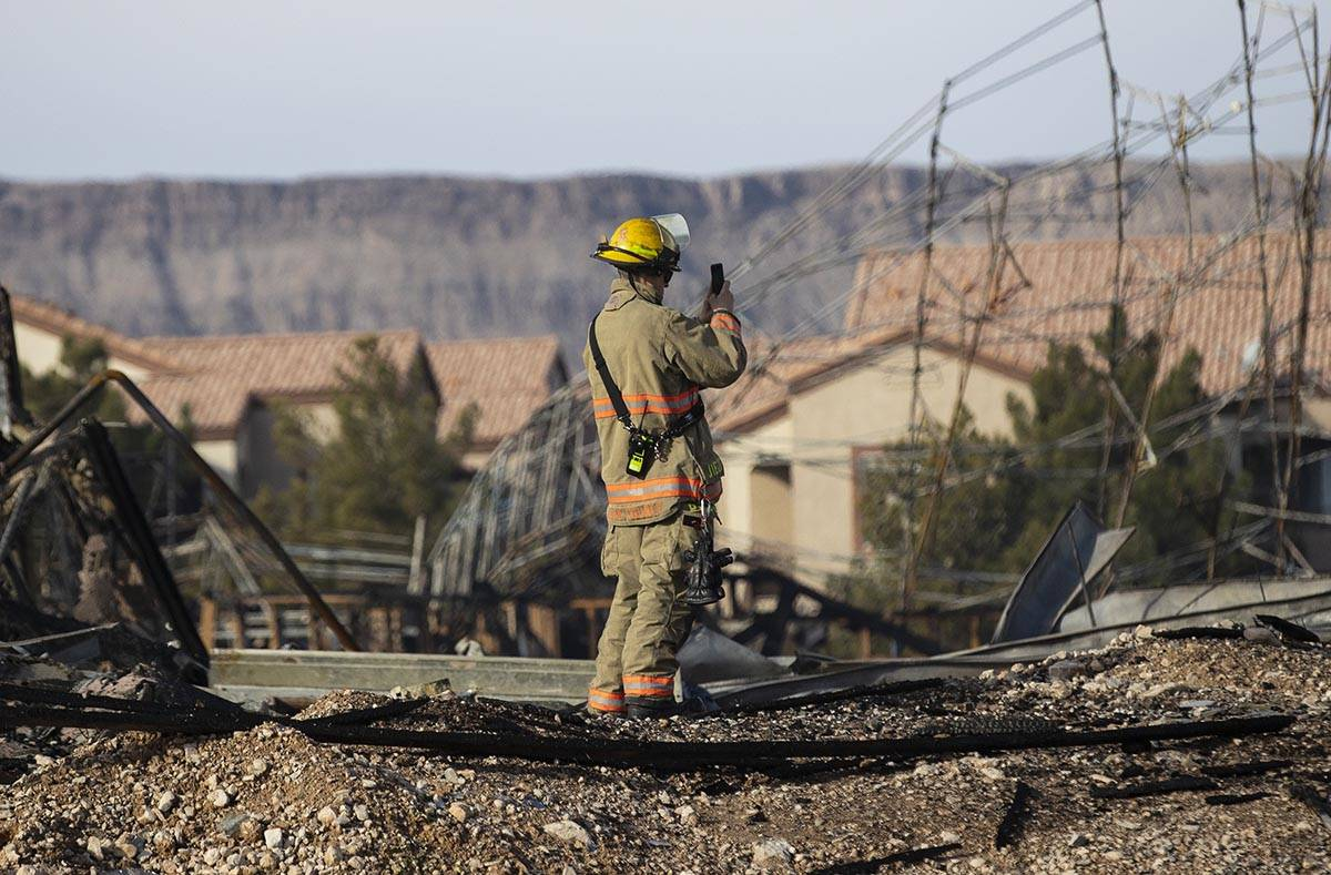 A Clark County firefighter surveys the damage done by fire to an under-construction Ely at Fort ...
