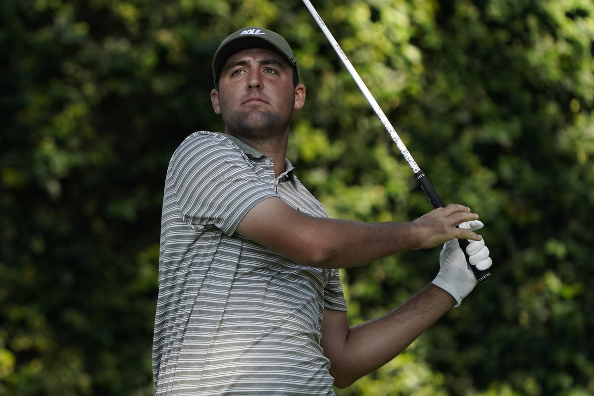 Scottie Scheffler watches his tee shot on the second hole during the third round of the Masters ...