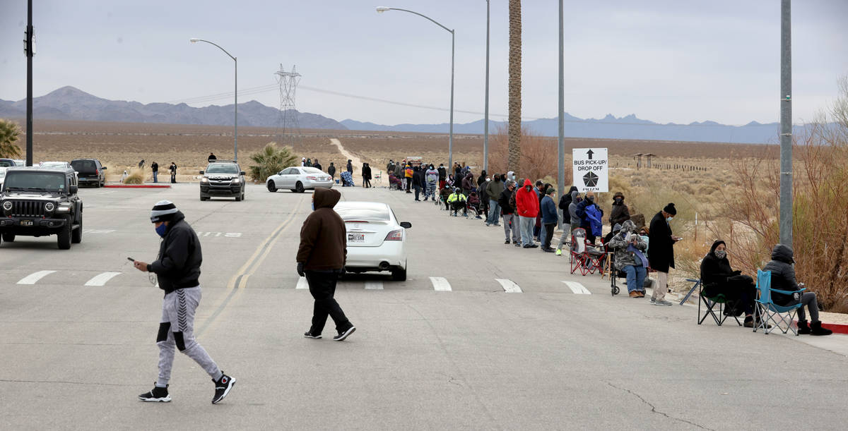 People line up to buy Powerball and Mega Millions lottery tickets at the Primm Valley Lotto Sto ...