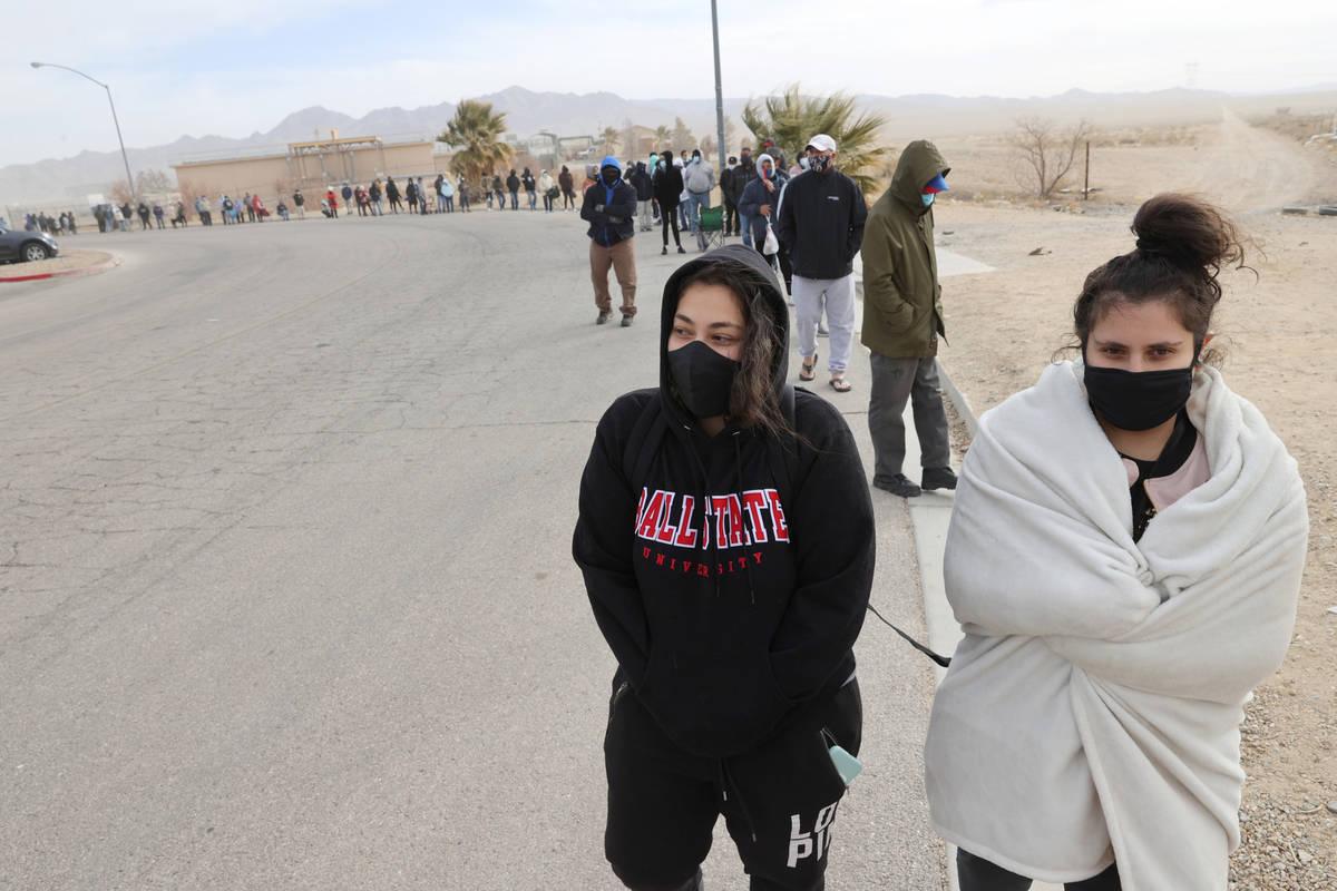 Sisters Fadia Salman, 25, left, and Hilda Salman, 23, both of Las Vegas, line up to buy Powerba ...