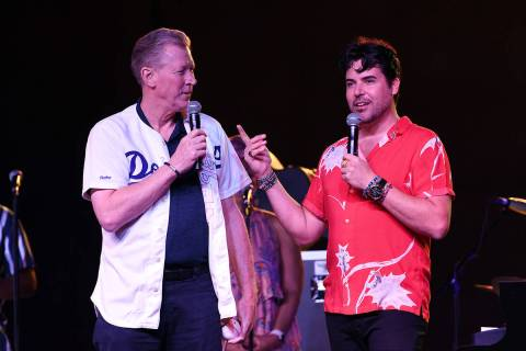 Major League great Orel Hershiser, left, joins Frankie Moreno onstage at The Amp at Craig Ranch ...
