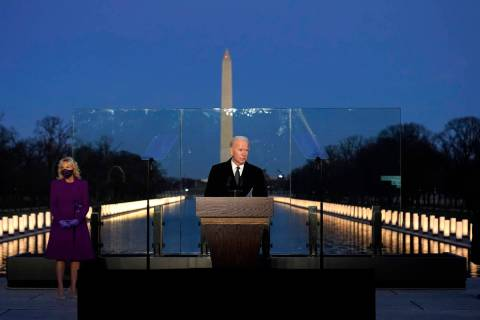 President-elect Joe Biden speaks during a COVID-19 memorial, with lights placed around the Linc ...
