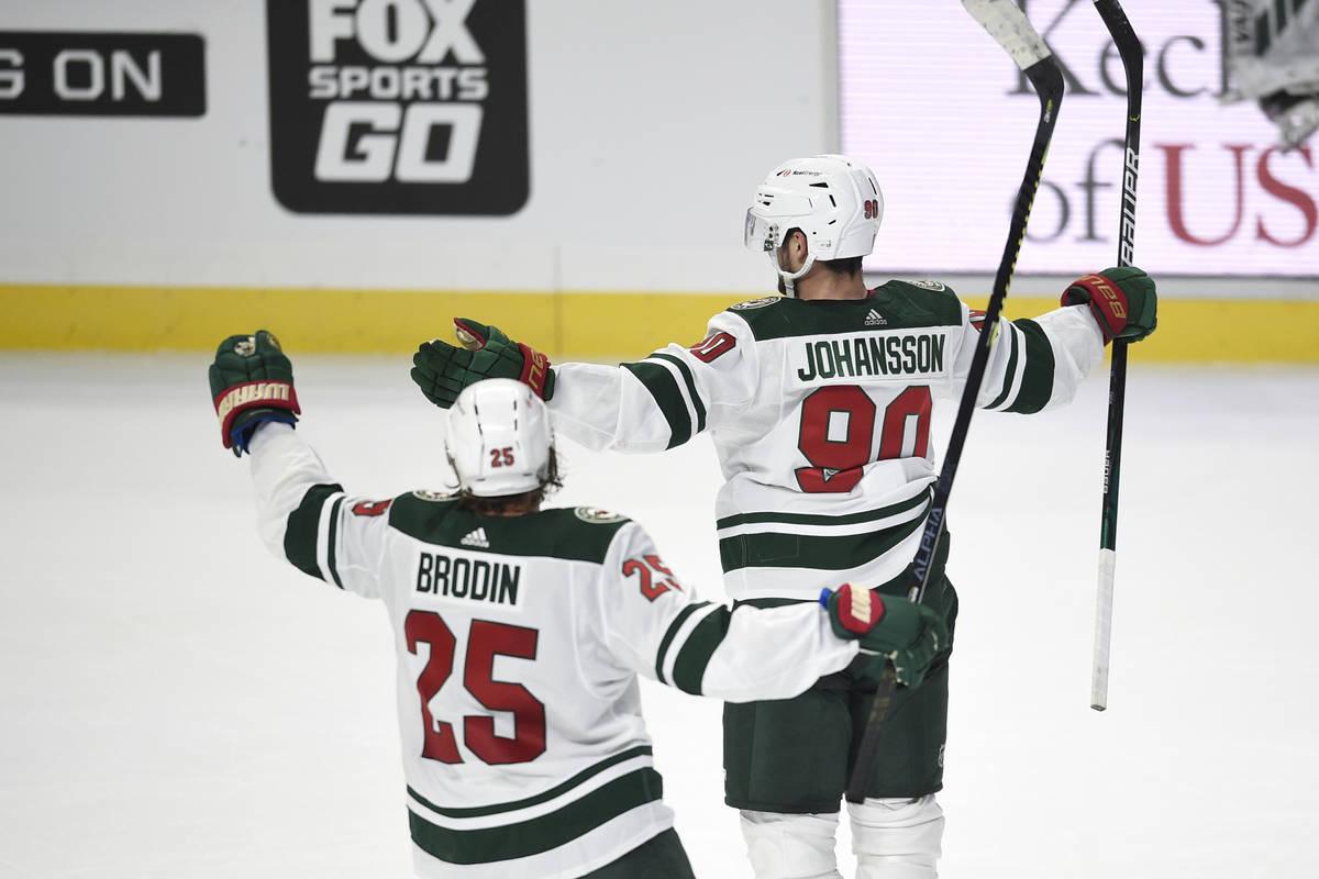 Minnesota Wild center Marcus Johansson, right, celebrates his game-winning goal in front of Jon ...
