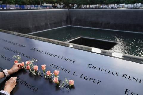 FILE - In this Sept. 11, 2020, file photo, mourners place flowers in the name cut-out of Kyung ...