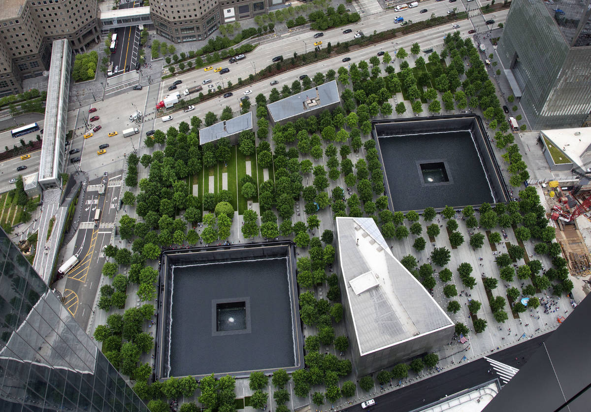 FILE - In this June 7, 2018, file photo, the September 11 Memorial and Museum are seen from an ...