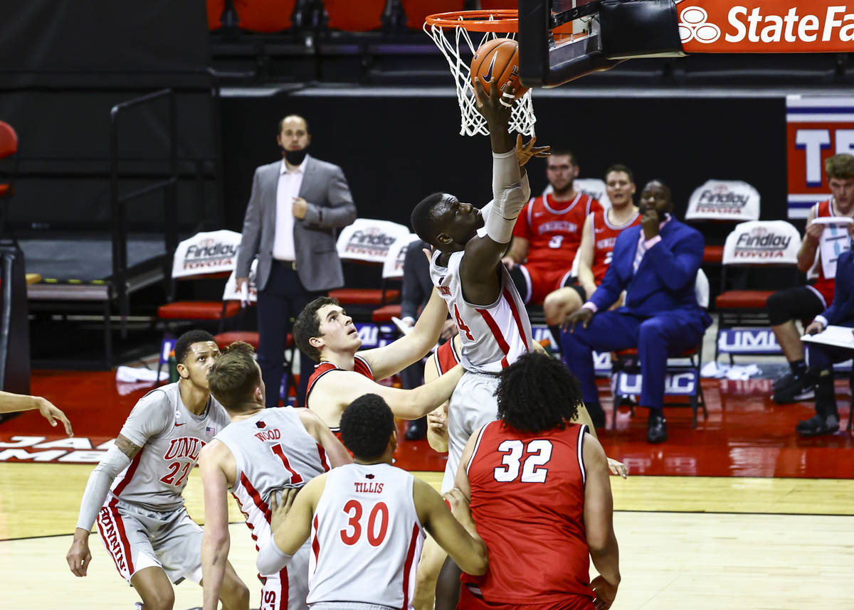 UNLV Rebels forward Cheikh Mbacke Diong (34) goes to the basket against the Benedictine Mesa Re ...