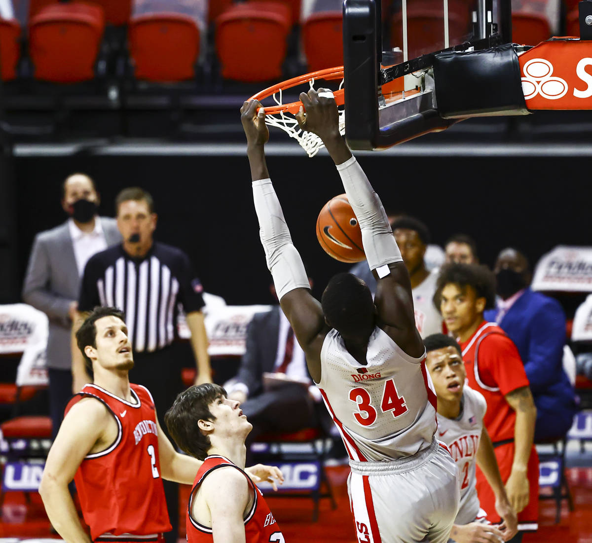 UNLV Rebels forward Cheikh Mbacke Diong (34) dunks the ball against the Benedictine Mesa Redhaw ...