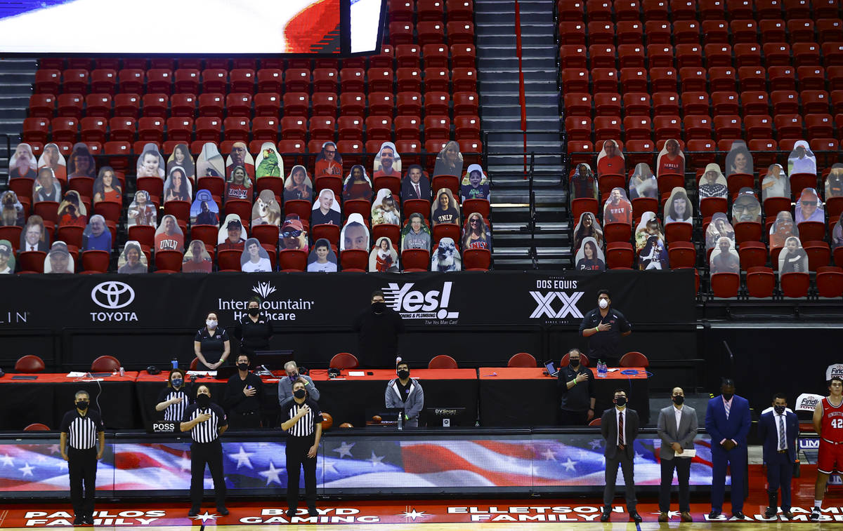 Officials stand for the national anthem before a basketball game between the UNLV Rebels and Be ...