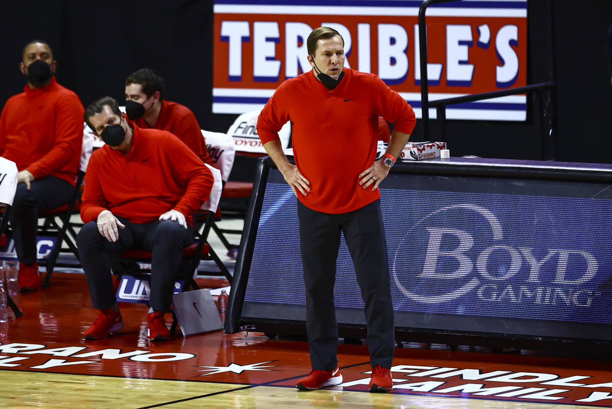 UNLV Rebels head coach T.J. Otzelberger looks on during the first half of a basketball game aga ...