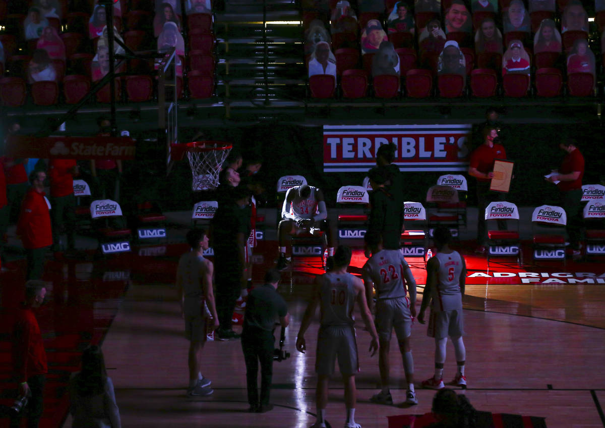 Light shines on UNLV Rebels forward Cheikh Mbacke Diong (34) as players are introduced before a ...