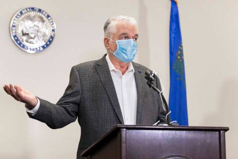 Gov. Steve Sisolak discusses Nevada's recent COVID-19 figures during a press conference ...