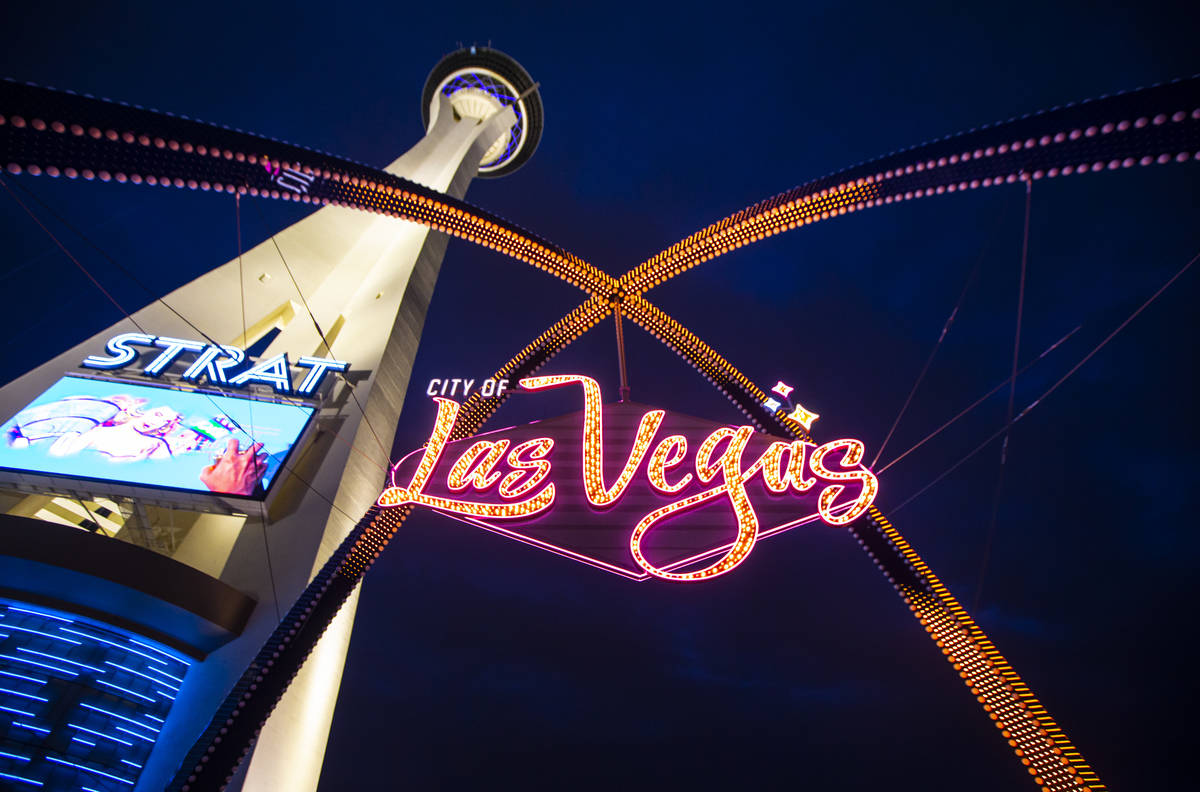Amber lights illuminate the gateway arches in downtown Las Vegas as part of a remembrance for v ...