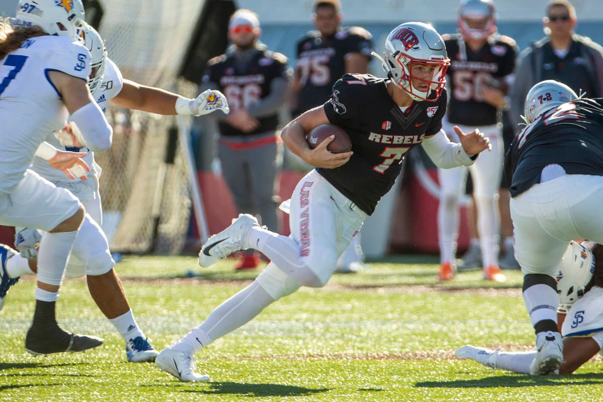 UNLV Rebels quarterback Kenyon Oblad (7) cuts up field through the San Jose State Spartans defe ...