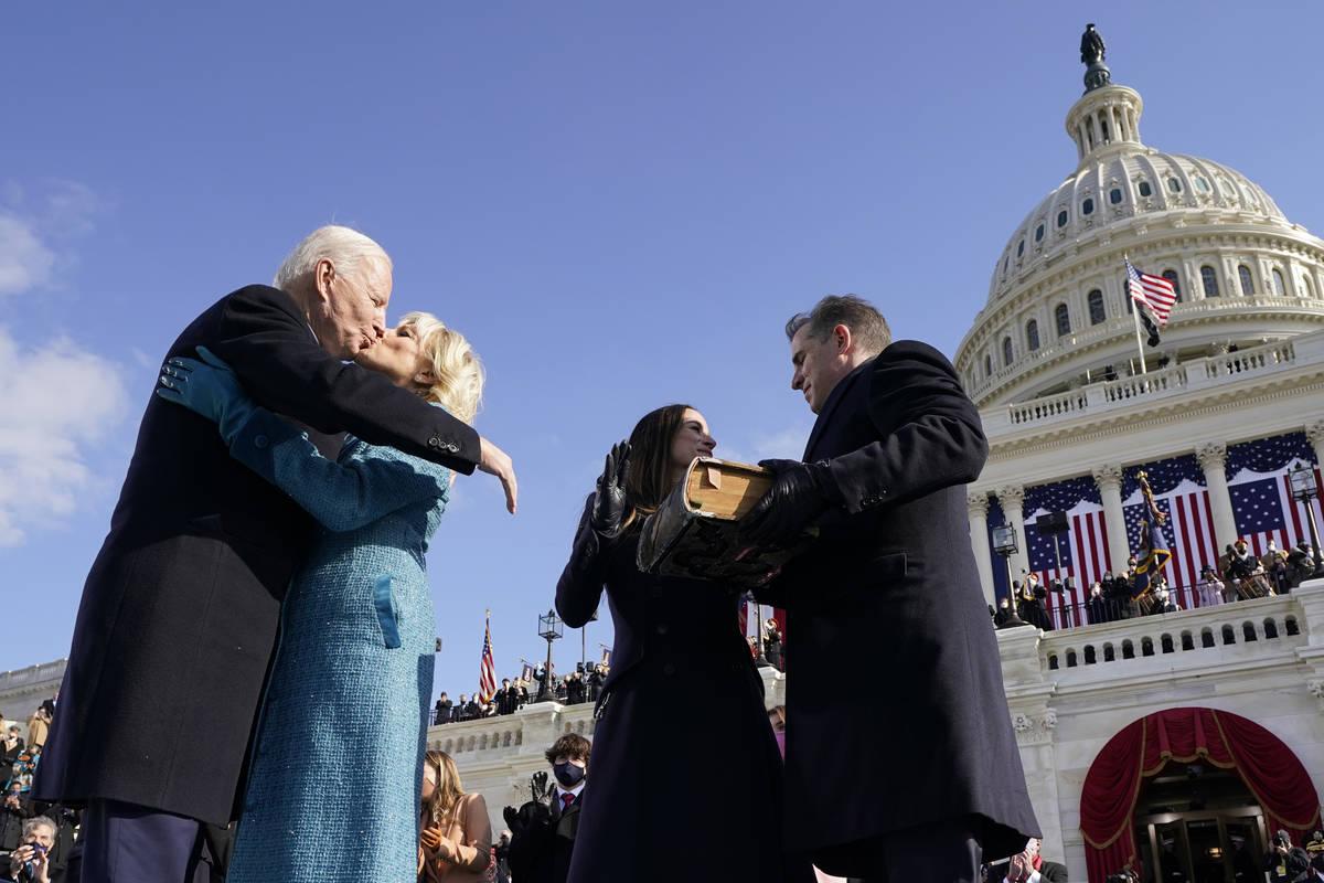 President Joe Biden kisses first lady Jill Biden, as his son Hunter Biden and daughter Ashley B ...