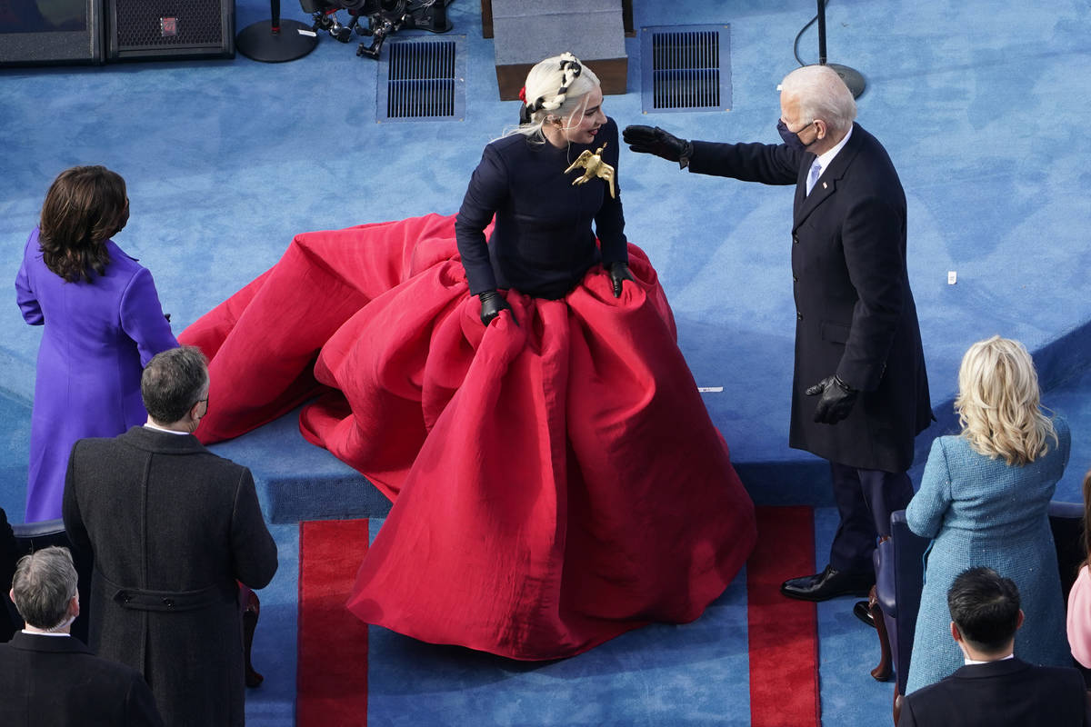 President-elect Joe Biden greets Lady Gaga during the 59th Presidential Inauguration at the U.S ...
