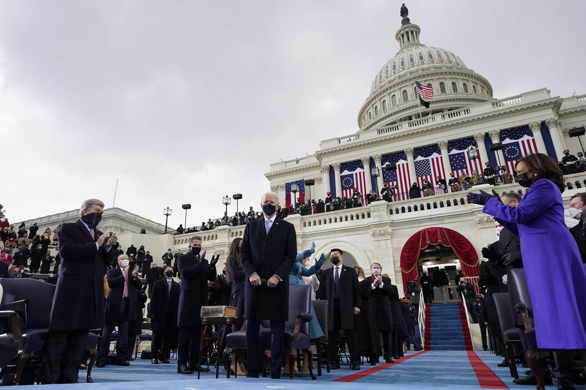 Vice President-elect Kamala Harris, right, applauds as President-elect Joe Biden arrives for th ...