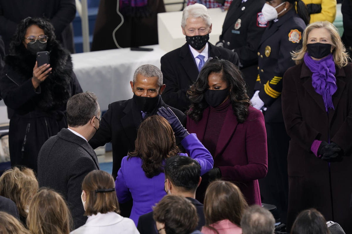 President-elect Kamala Harris and her husband Doug Emhoff talk with former President Barack Oba ...
